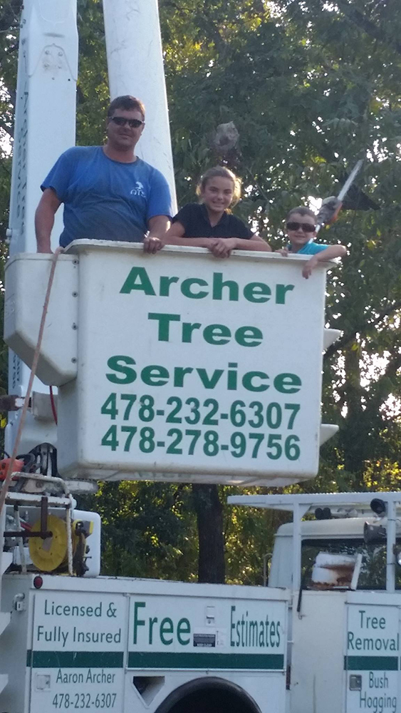 Archer Tree Service team member in company crane